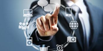 Businessman pressing virtual icons